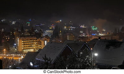Time lapse of night winter snow village. mountain tourism....
