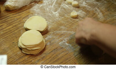 roll out the dough - a rolling pin to roll the dough for...