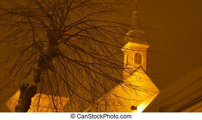 Snowy Night Tree and Church - Church minister view on during...