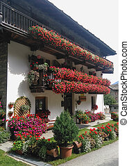 Mountain house adorned with flowers - house adorned with...