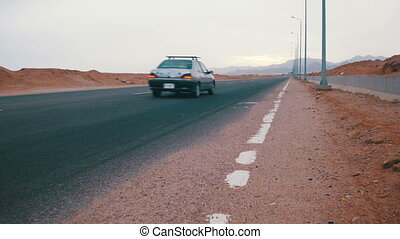 Car is Driving on the Desert Road - Asphalt Road on the...