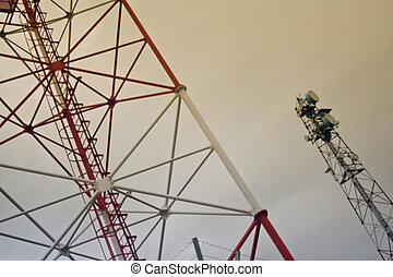 Telecommunication Towers - Two steel towers against cloudy...