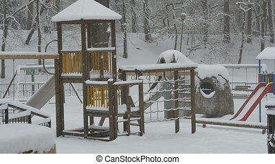 Snowing Park Playground - Snowfall in the park playground...