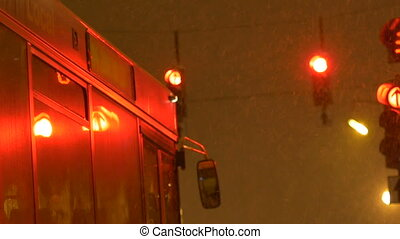 Stop Night Snowing Bus - Bus is waiting at the red semaphore...
