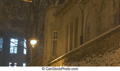 Night Snowing House Wall - Snowfall in the night near the...