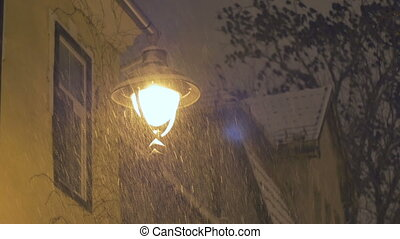 Abundant Night Snowing - Lamp post in the oldtown during a...