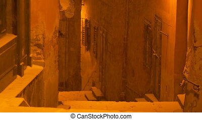 Nighttime Snowing on Medieval Stairs - Night snowfall over...