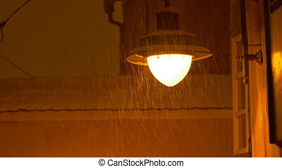 Outdoor Night Snowy Lamp - Night snowing over the city and a...