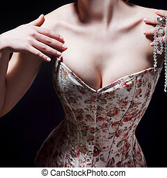 Beautiful young sexy woman in a corset with floral pattern -...