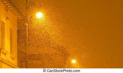 Thick Night Snowing in City - Dense snowfall scene during...