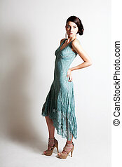 Beautiful Young Woman in an Elegant Evening Gown
