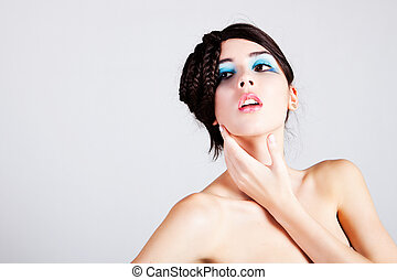 Beautiful Young Woman with an Exotic Hairstyle