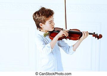 boy playing violin - Elegant nine year old boy playing the...