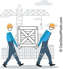 Two workers moving boxes together - Construction workers at...
