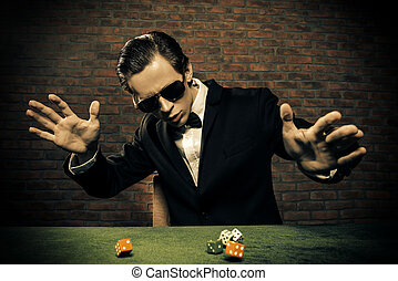 good luck - Excited gambling man throwing dice on a game...