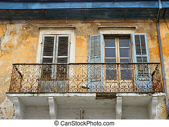 Balcony and windows with of an old abandoned house in...