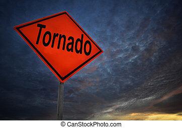 Orange storm road sign of tornado