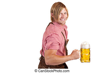 Bavarian man shows biceps muscles and holds oktoberfest beer...