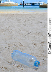 Plastic waste disposed near water - Garbage and litter waste...