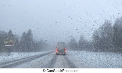 Driving in winter on snow-covered roads. inside of the car