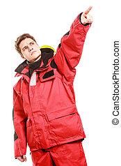 Adventurous man making gesture. Young male in weatherproof...