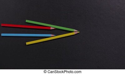 Pointing arrows out of pencils - Multicolored pencils are...