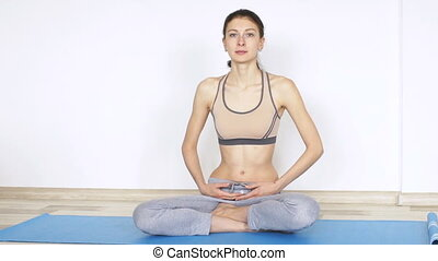 Young woman doing yoga exercise standing still slowmotion