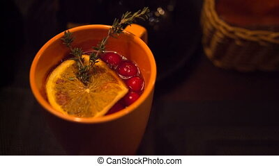 delicious hot tea with lemon and cranberry closeup -...