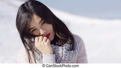 Happy cute asian girl enjoying her winter time - Happy cute...
