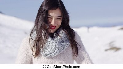 Happy young asian girl enjoys snowy winter in high...