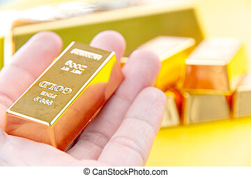 gold bars - image of Hand hold gold bars