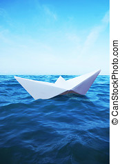 Paper Boat sails on the sea