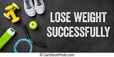 Fitness equipment on a dark background - Lose weight...