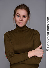 Beautiful confused woman with a raised eyebrow. Isolated on...