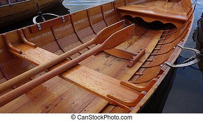 Wooden Rowing Boat - Close-up of wooden rowing boat with...