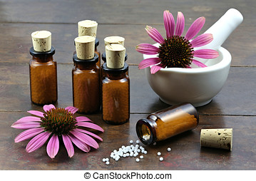 homeopathic echinacea pills in brown bottles on wooden...