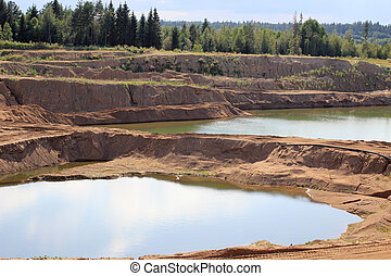 Large sand pit with water