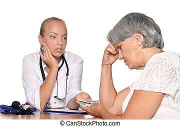 doctor give pills to her patient, mature woman upset