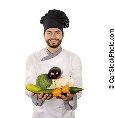 smiling chef with vegetables in hands isolated on white
