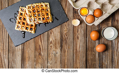 Viennese waffle on wooden table - Viennese waffles, eggs in...