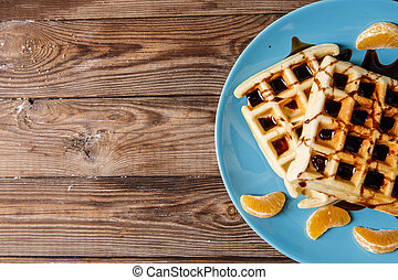 Home waffles on blue plate - Photo of home waffles on blue...