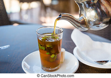 Traditional mint tea, also known as Berber whiskey, Morocco...