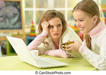 Mother with doghter play videogames - Portrait of young...