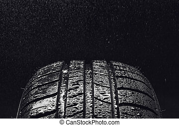 Summer fuel efficient car tires with water droplets - Studio...