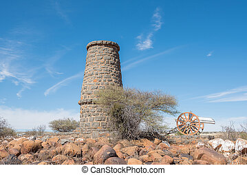 Monument and cannon in Koffiefontein - A monument in...