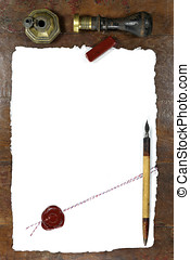 handmade paper with wax seal, dip pen and inkwell on wooden...