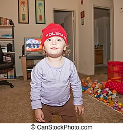 Red Hat - Polska - Caucasian baby girl in red hat playing at...