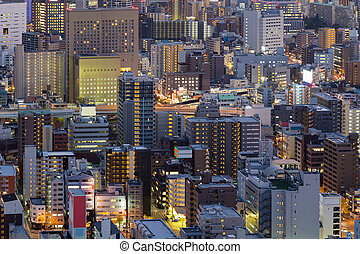 Osaka business district, city downtown aerial view at night,...