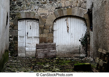 Alley with 2 white doors - Dead end alley with 2 old white...