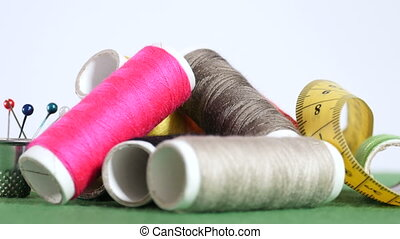 Tools and supplies for sewing - Bobbins with colorful...